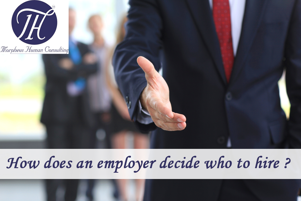How does an employer decide who to hire ?